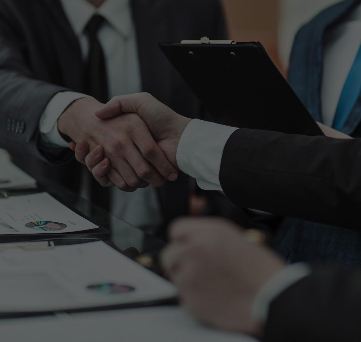 Businessmen agree a deal