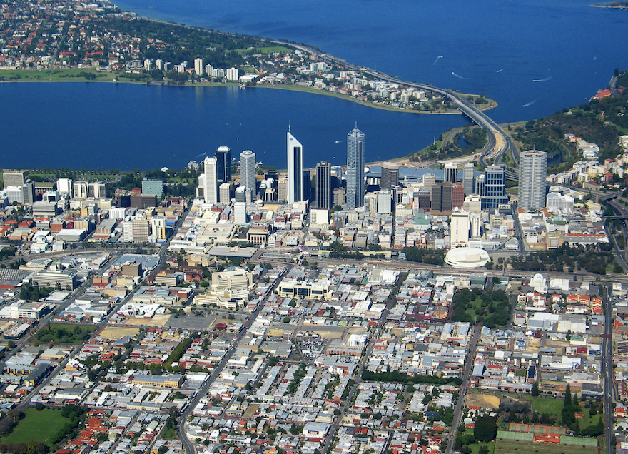 A birds eye view of Perth City high rises and swan river in the background.